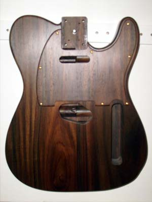 Solid santos rosewood with matching rosewood - maple laminated pick guard
