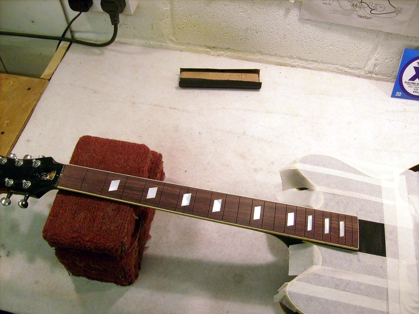 With fretboard reshot